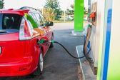 Gas pump nozzle in the fuel tank of a car. — Stock Photo