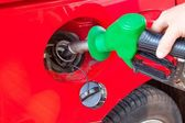 Person refueling a car at gas station — Stock Photo