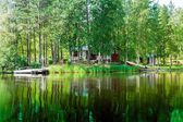 Old Finnish summer cottage at a lake  — Stock Photo