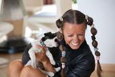 Young women playing with puppy — Stock Photo