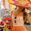 Cute girl in a sombrero — Stock Photo #32054871
