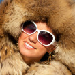 Portrait of nice girl in fox fur — Stock Photo