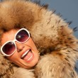 closeup portrait of beautiful smiling young woman in fur — Stock Photo