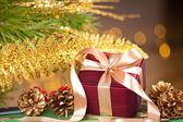 Elegant gift box on defocused lights background — Stock Photo