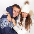 Winter fashion beautiful man and woman in fur coat — Stock Photo
