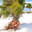Young couple having fun in a caribbean beach — Stock Photo #37140103