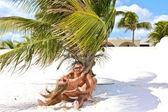 Young couple having fun in a caribbean beach — Stock Photo