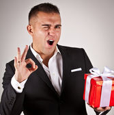 Elegant young man with present — Stock Photo