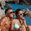 Happy young couple enjoying sun — Stok fotoğraf