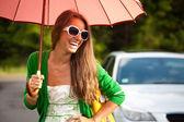 Glamour Happy woman under umbrella — Stock Photo