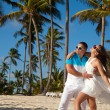 Beautiful couple on the beach in wedding dress — Stock Photo