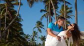 Loving couple - beach at summer - the romantic date or wedding o — Stock Photo