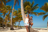 Beautiful couple on beach on vacation travel — Stock Photo