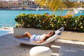 Young sexy woman in white dress relaxing in paradise, luxury res — Stock Photo