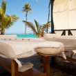Massage tables in tropical beach — Stock Photo