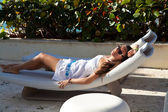 Young sexy woman in white dress relaxing in paradise, luxury res — Foto de Stock
