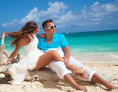 Couple at Tropical white sand virgin beach — Stock Photo