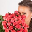 Beautiful woman with a bouquet of roses — Stock Photo #47319307