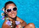 Sexy girl sitting near swimming pool — Stock Photo