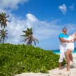 Picture of happy loving couple having fun on the beach — Stock Photo #48100579