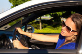 Smiling woman sitting in car — Foto Stock