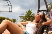 Young woman relaxing outdoor, female sitting on the terrace — Stock Photo