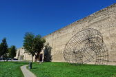 Ancient walls of Prato with a monument to mazzocchio, Tuscany, Italy — Stock Photo