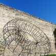 Stock Photo: Ancient walls of Prato with monument to mazzocchio, Tuscany, Italy