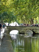 Channel with bridge in Nimes, France — Stock Photo
