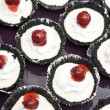 Stock Photo: Chocolate cupcakes with cherry jam