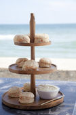 Salmon scones on the beach — Foto Stock