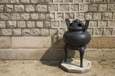 Incense pot in front of wall — Stock Photo