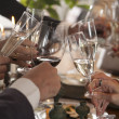 Hands of people toasting in party — Stock Photo