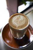 Hot cappuccino with latte art — Stock Photo