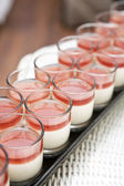 Row of panacotta in party — Stock Photo