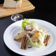 Стоковое фото: Caesar Salad on white plate with wine