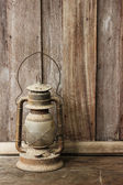 Old lantern on wooden background — Stock Photo