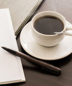 Open a blank white notebook, pen and cup of coffee — Stock Photo