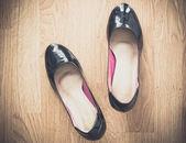 Black shoes on wood background — Stock Photo