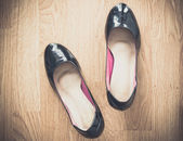 Black shoes on wood background — ストック写真