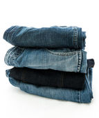 Stack of jeans isolated on white background — Stock Photo