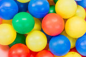 Many colour plastic balls — Stock Photo