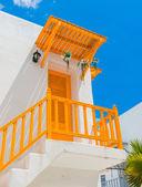 Yellow balcony and door and white wall — Stock Photo