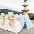 Wedding chairs in row decorated with golden color ribbon — Foto Stock