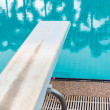 Stock Photo: Springboard to dive at swimmingpool