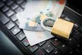 Padlock and credit cards on top of laptop — Stock Photo
