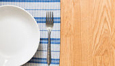 White plate and silver fork — Stock Photo