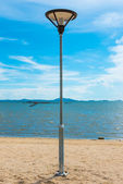 Light pole on beach — Stock Photo
