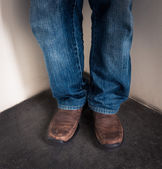 Closeup leg of Young man standing in corner — Stock Photo