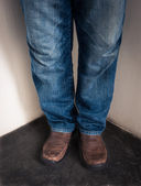 Closeup leg of Young man standing in corner — Foto Stock